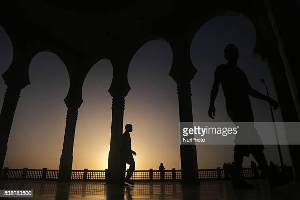 Palestinian walks Al Khalde mosque during sunset in the west of Jabaliya during the Muslim holy month Ramadan, in the Gaza town of Jabaliya, on June...