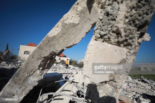 Palestinian walks over the rubbles of jailed Palestinian Ahmad Qunbu's house, demolished by Israeli soldiers in Jenin, West Bank on February 6, 2020.