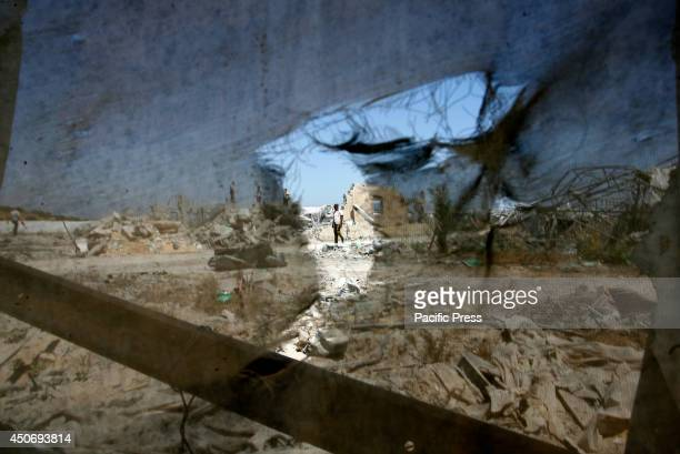 Palestinian walks past the aftermath of an Israeli air strike in Rafah in the southern Gaza Strip. Israeli war jets on Saturday night carried out a...