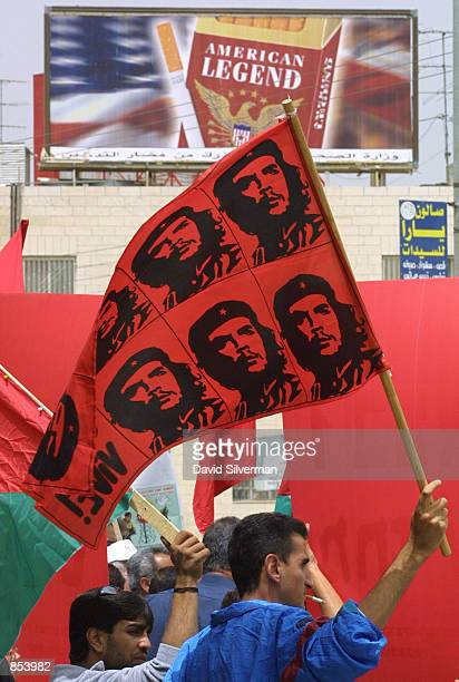Palestinian waves a Che Guevara flag during an antiIsraeli demonstration near the A''Ram roadblock April 30 2001 on the northern border of Jerusalem...