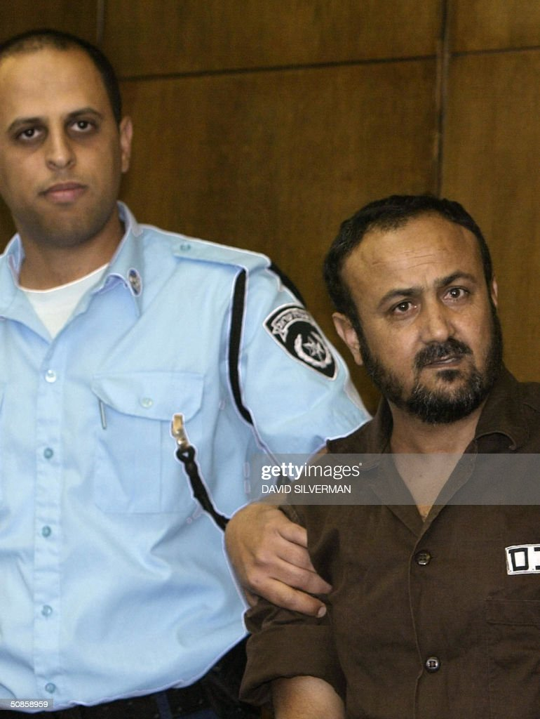 Palestinian West Bank Fatah leader Marwan Barghuti arrives in the Tel Aviv district court 20 May 2004. Barghuti, who was found guilty on several counts of murder by the court, will be handed down his sentence on June 6. The 44-year-old member of the Palestinian parliament is charged with 26 counts of murder and heading Al-Aqsa Martyrs Brigades, an armed offshoot of Fatah responsible for a string of deadly anti-Israel attacks. AFP PHOTO/POOL/David SILVERMAN