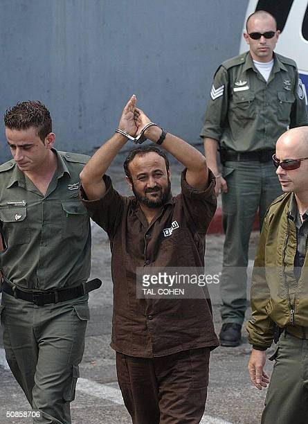 Palestinian West Bank Fatah leader Marwan Barghuti flanked by Israeli guards walks into a Tel Aviv court 20 May 2004 An Israeli court was expected to...