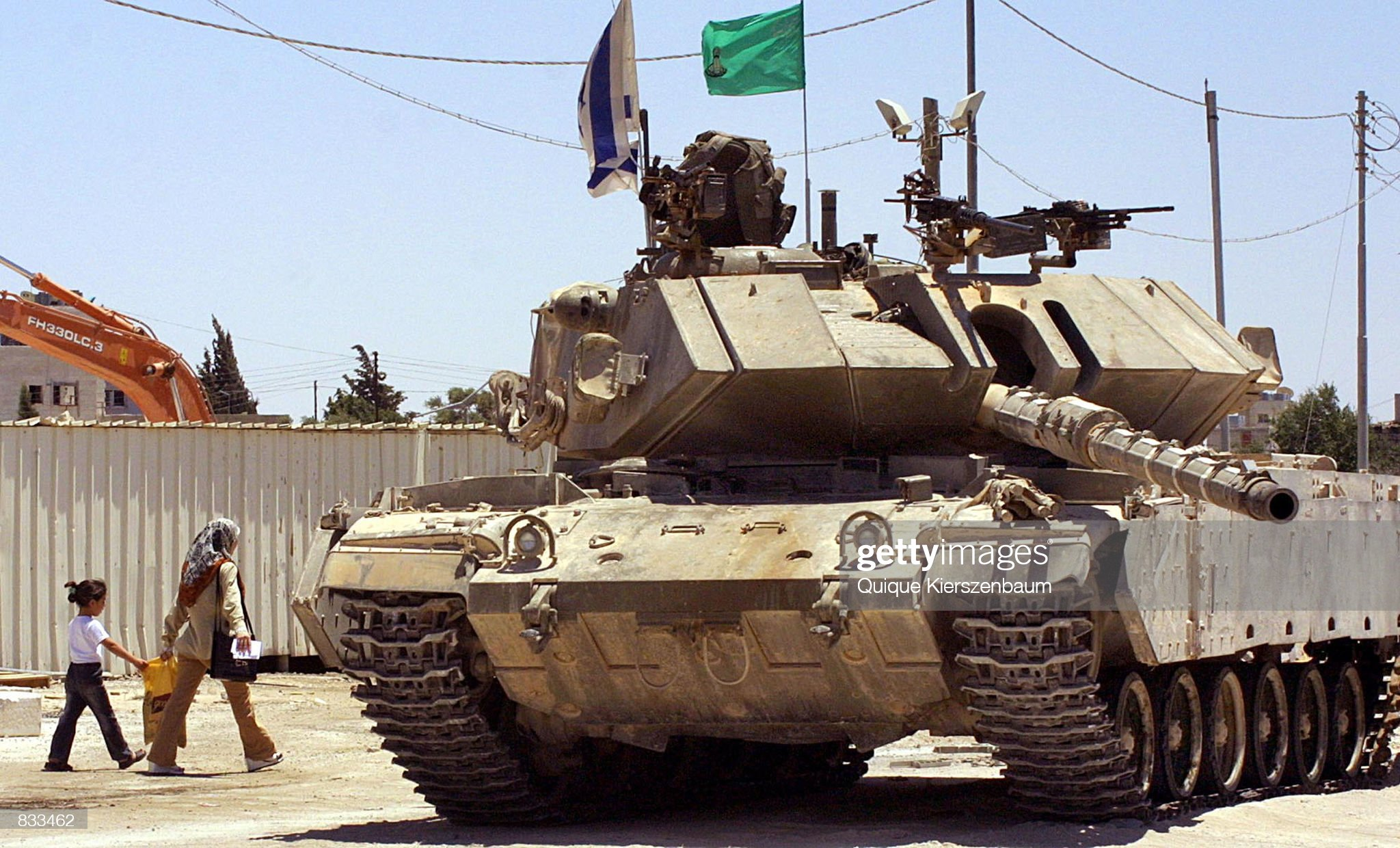 https://media.gettyimages.com/photos/palestinian-woman-and-her-daughter-pass-by-an-israeli-tank-as-they-picture-id833462?s=2048x2048