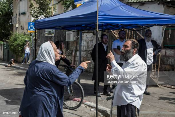 Palestinian woman argues with a Jewish man in the neighborhood of Sheikh Jarrah, during Israel's 'Jerusalem Day' on May 10, 2021 in Jerusalem,...