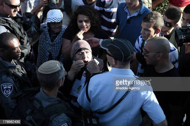 Palestinian woman argues with Israeli security forces during a demonstration on August 26 2013 in Jerusalem The demonstrators are protesting after...
