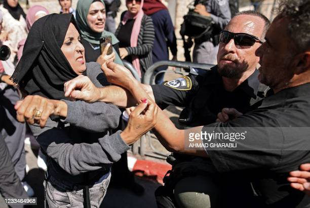 Palestinian woman confronts Israeli security forces outside the Damascus gate in east Jerusalem, on June 15 ahead of the March of the Flags which...