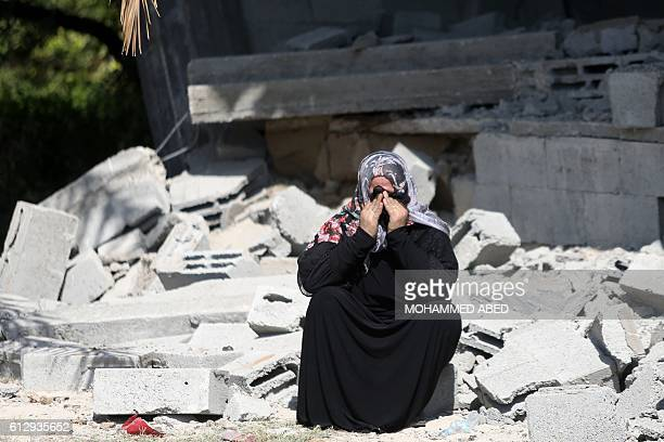 A Palestinian woman cries at a site that was hit by an Israeli air strike the previous day in Gaza City on October 6 2016 Israel's military said it...