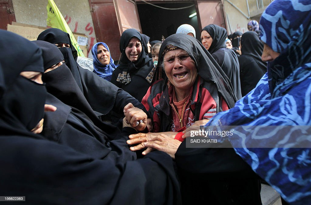 A Palestinian woman cries during the funeral of her husband in the southern Gaza Strip town of Khan Yunis, on November 22, 2012. Ibraham Abu Tair, 80, was killed with his granddaughter in an Israeli air strike on the area the previous day, according to Palestinian sourcesas an Egypt-brokered truce took hold in the Gaza Strip, ending eight-day operation during which the Israeli army said it hit more than 1,500 targets, while Gaza militants fired 1,354 rockets over the border.