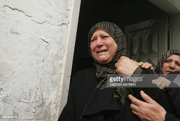 A Palestinian woman cries during the funeral of militant Mahmud Hamad who was killed in an Israeli air strike on March 5 2009 Israeli air raids on...