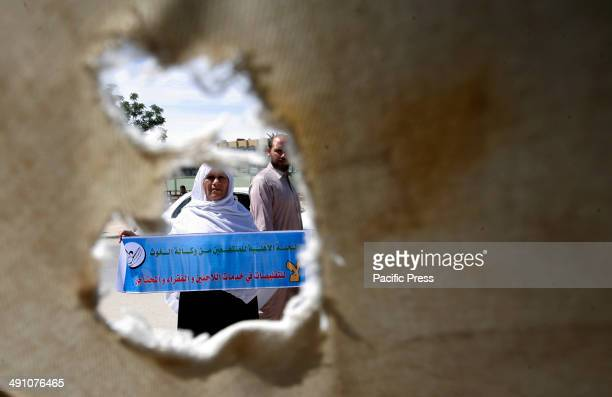 Palestinian woman during a protest in front of the UNRWA headquarters against their decision to reduce aid in the Rafah refugee camp in the southern...