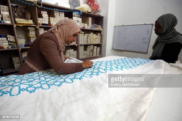 A Palestinian woman embroiders at a workshop in Jordan's Jerash Palestinian refugee camp which was established to host more than 11000 Palestinians...