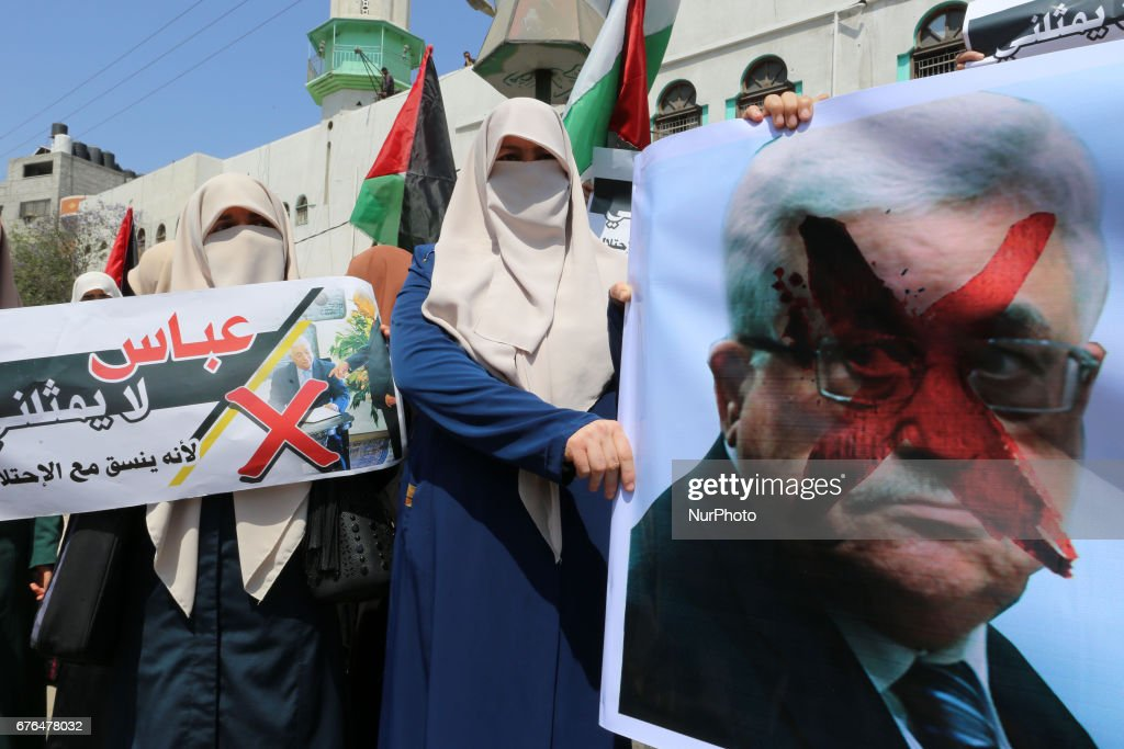 Palestinian woman hold signs as supporters of Hamas, Jihad Islamic and Al Ahrar movement gather to protest against President of the State of Palestine and Palestinian National Authority Mahmoud Abbas and to demand an end to the Israeli blockade of the Gaza Strip on 2 May 2017 , on May 2 in Gaza