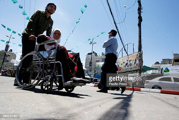 Palestinian woman in a wheelchair in the street of Rafah town in the southern Gaza Strip.
