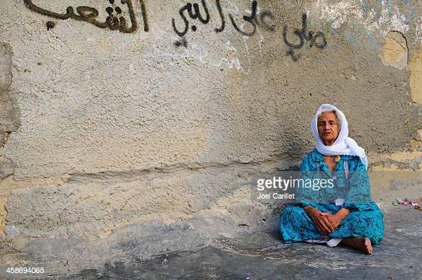 palestinian woman in refugee camp - palestinian stock pictures, royalty-free photos & images