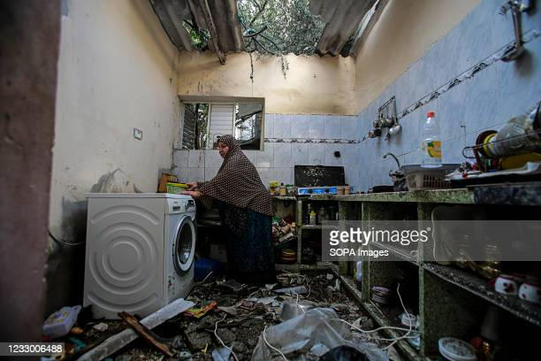 Palestinian woman inspects her destroyed house after Israeli air strikes in Jabaliya refugee camp. Israel and the Palestinians are mired in their...