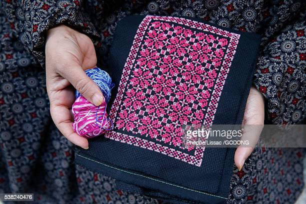 palestinian woman making embroidery in amari refugee camp. - embroidery stock pictures, royalty-free photos & images