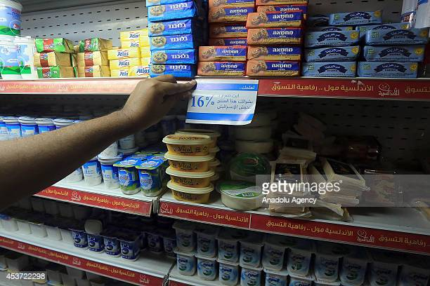 Palestinian woman marks Israeli products to boycott at the markets in Gaza city Gaza on August 16 2014 Apart from killing hundreds of Palestinians...