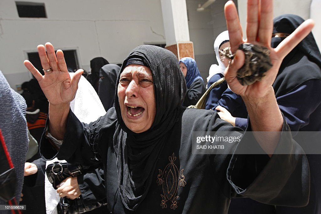 A Palestinian woman mourns during the funeral of Mohamed Shahoan in the southern Gaza Strip town of Khan Yunis on June 2, 2010, one day after he was shot dead by Israeli troops as he inflitrated southern Israel.
