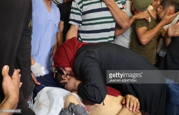 Palestinian woman mourns of the body of her son, Mohammad Said Hamayel at a hospital in Nablus, where he was transported after being injured while...