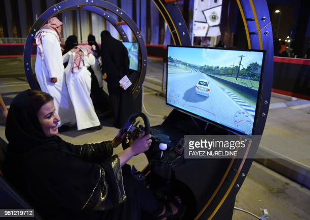 Palestinian woman residing in Saudi Arabia uses an electronic driving simulator during a gocart driving workshop for women in the Saudi capital...
