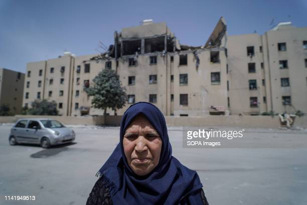 Palestinian woman seen standing next to the damaged house of the deceased during the funeral of Maria alGazali a fourmonthold Palestinian baby who...