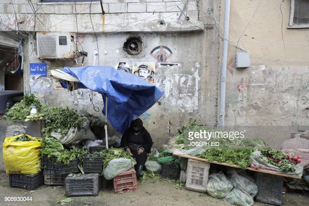 Palestinian woman sells vegetables at the Burj alBarajneh camp in the Lebanese capital Beirut on January 17 2018 The UN agency for Palestinian...