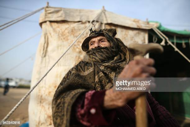 Palestinian woman sits next to a tent near to the site of clashes between Palestinian demonstrators and Israeli security forces following a protest...