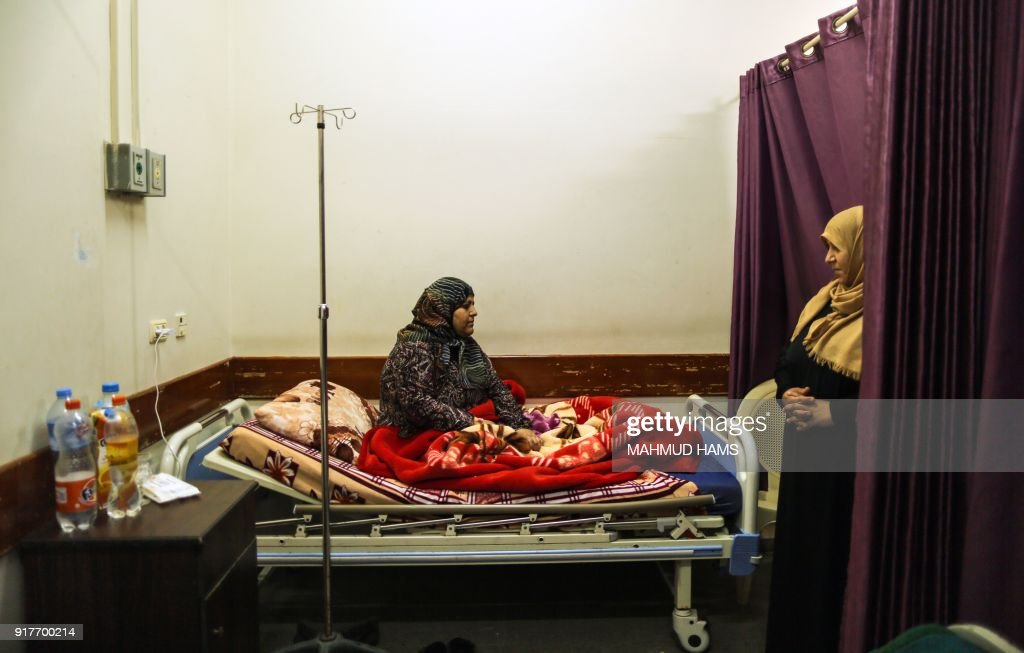 A Palestinian woman suffering from cancer is seen at a hospital in