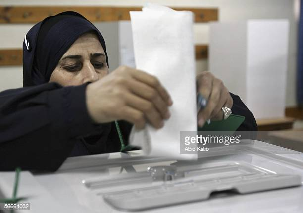 Palestinian woman votes for the Palestinian legislative candidates in the UN school Alef which is being used as an election station January 25 2006...