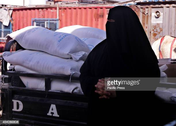 Palestinian woman waiting for aid from the UNRWA after the war ended officially in Rafah Southern Gaza strip