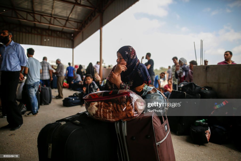 A Palestinian woman waits to cross the Rafah Border crossing with her luggages, in Rafah in the southern Gaza Strip, on August 16, 2017.