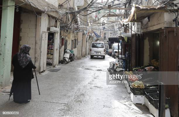 A Palestinian woman walks in the Burj alBarajneh camp in the Lebanese capital Beirut on January 17 2018 The UN agency for Palestinian refugees warned...