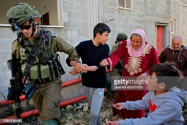 TOPSHOT Palestinian women and youths from the village of Kfar Qaddum near Nablus in the occupied West Bank scuffle with Israeli soldiers as they try...