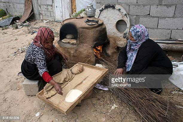 Palestinian women bake bread on March 30 in Khan Yunis in the southern Gaza Strip as Palestinians mark Land Day On the annual Land Day demonstrations...