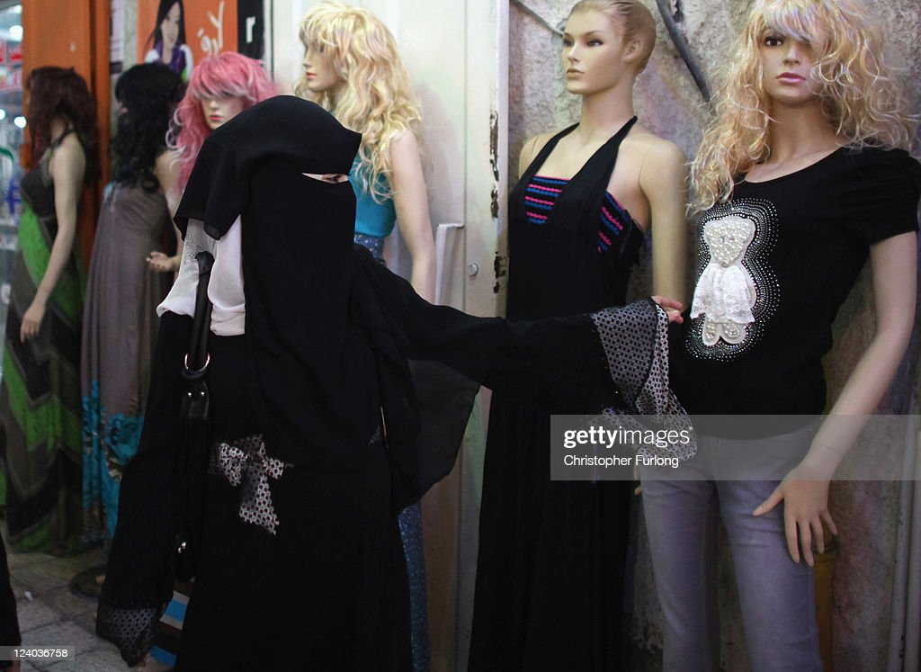 Palestinian women browse fashionable clothes in a shopping mall, on August 17, 2011 in Gaza City, Gaza. Palestinian President Mahmoud Abbas will formally submit the application for Palestinian statehood to the 66th United Nations General Assembly in New York on September 20th. The Palestinians and the Israelis are taking part in global diplomatic lobbying to win support for their differing positions on statehood. The Palestinian bid arises from two decades of on-and-off peace talks that have failed to produce a deal. The ultimate goal of the Palestinian Authority is to end Israeli occupation and to establish a sovereign and independent state on the 1967 borders with Jerusalem as its capital.