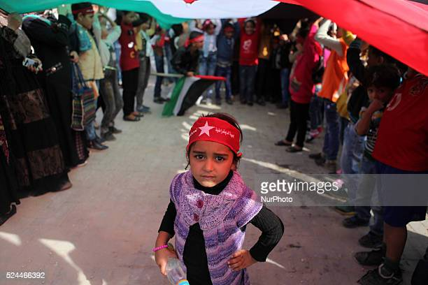 Palestinian women chant slogans and wave Palestinian and red flags background that represent the Palestinian MarxistLeninist secular political and...