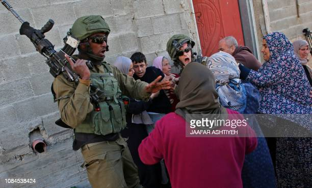 TOPSHOT Palestinian women from the village of Kfar Qaddum near Nablus in the occupied West Bank scuffle with Israeli soldiers as they try to release...