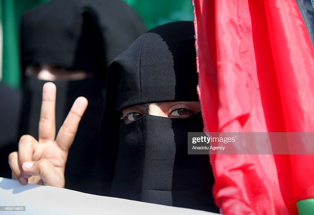 Palestinian women gathering outside the United Nations Educational, Scientific and Cultural Organization (UNESCO) headquarters in Gaza City attend a march staged by Islamic Resistance Movement (Hamas) to mark International Women's Day on March 8, 2015.