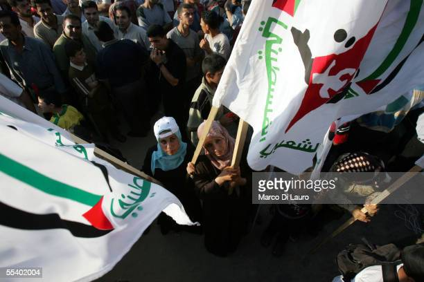 Palestinian women hold Al Aqsa military wing of Fatah movement flags at rally in the former Jewish settlement of Neve Dekalim on September 14 2005 in...