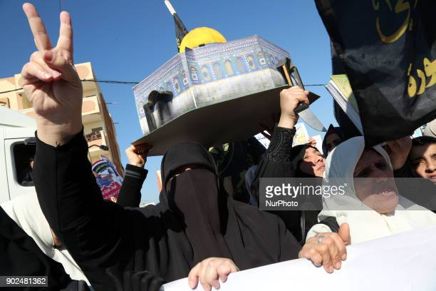 Palestinian women holds a miniature replica of the Dome of the Rock during a protest against US President Donald Trump's decision to recognise...