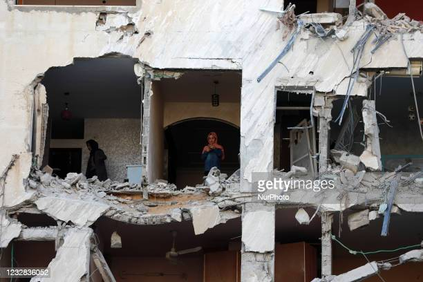 Palestinian women inspecting the rubble of a building following an Israeli air strike on Gaza City on May 12, 2021.