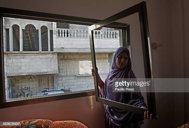 Palestinian women inspects the damage of an Israeli air strike in her home at Khan Younis in the Southern of Gaza City. According to the Palestinians...