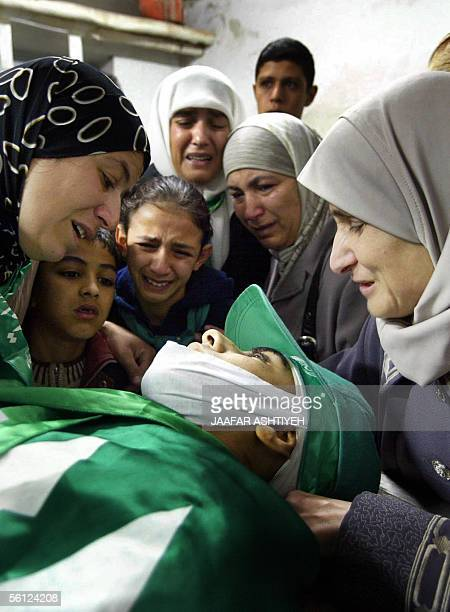 Palestinian women mourn 20 November 20005 over the body of fifteenyearold Mohammed Abu Salha who was killed yesterday as he and at least two other...