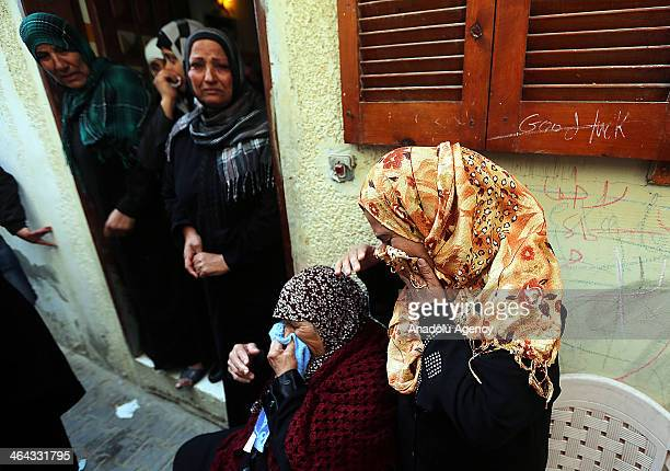 Palestinian women mourn during the funeral of Ahmed and Mahmoud alZa'anin who were killed in an Israeli air strike in the northern Gaza Strip town of...