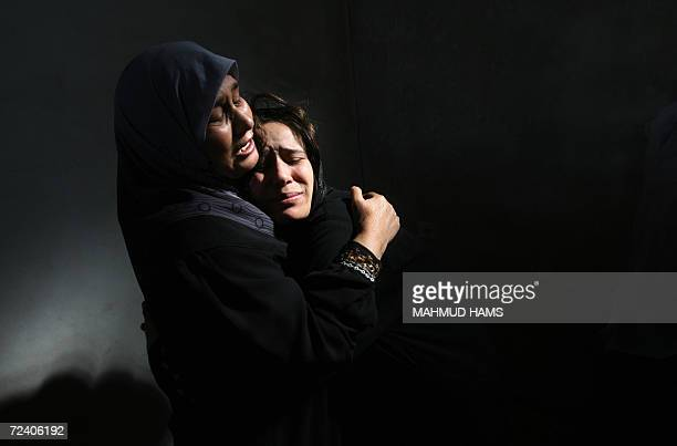 Palestinian women mourn during the funeral of Ayman and Raed Yassin in Beit Lahia, 04 November 2006. The brothers, both in their twenties, were...