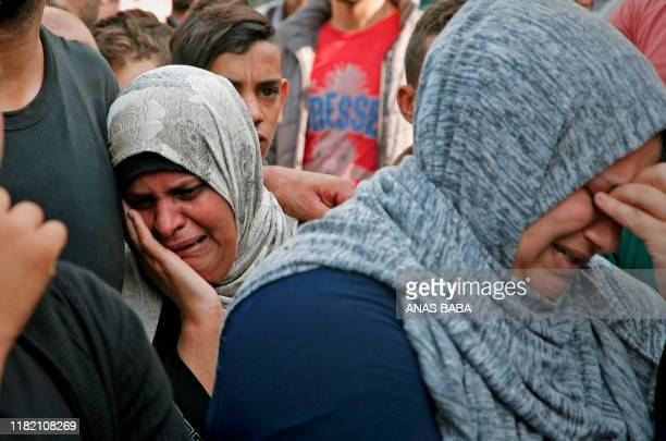 Palestinian women mourn outside the mortuary of Gaza City's AlShifa hospital on November 13 after two more Palestinians were killed in the morning in...