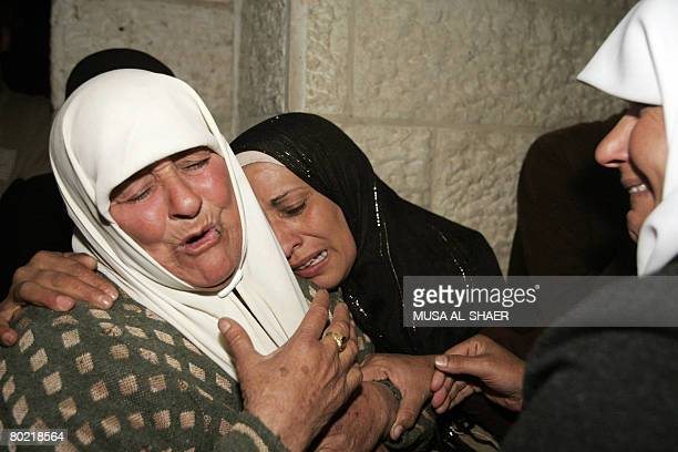 Palestinian women mourn the death of a relative killed by Israeli undercover forces in the West Bank town of Bethlehem on March 12 2008 Israeli...