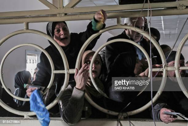 Palestinian women shout as Gazans wait for permission to cross into Egypt through the Rafah border crossing in the southern Gaza Strip after it was...