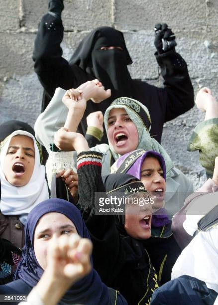 Palestinian women supporters of the Islamic Jihad group shout slogans against Israel during a rally in support of Mekled Hameid the leader of their...