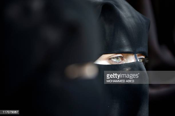 Palestinian women supporters of the Islamist movement Hamas demonstrate against the introduction of a ban on the wearing of veils in France on June...